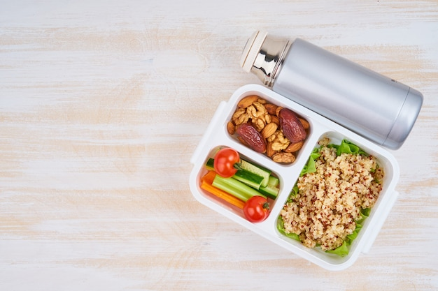 Vegan lunch box, thermos, copy space. healthy vegetarian menu, weight loss, healthy lifestyle