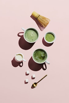 Vegan matcha latte with oat milk on pink