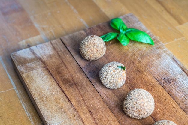 Vegan meatballs on a rustic wooden table