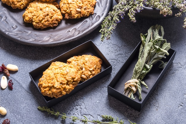 Vegan oat cookies in black carton box