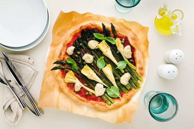 Vegan pizza with asparagus and artichokes