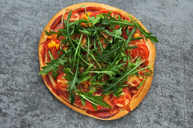 Vegan pizza with fresh arugula. healthy food.