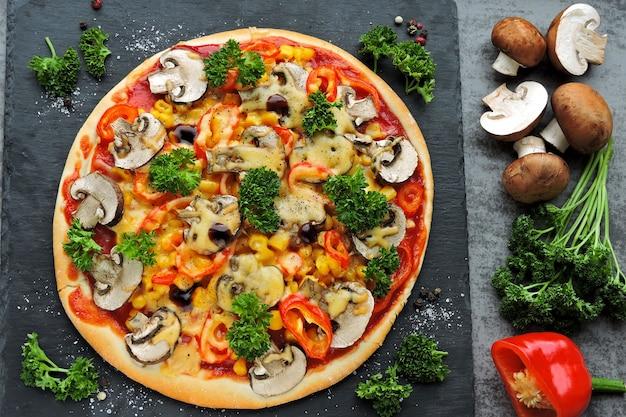 Vegan pizza with mushrooms, vegetables and herbs. keto diet. pegan diet.
