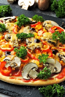 Vegan pizza with vegetables and mushrooms.