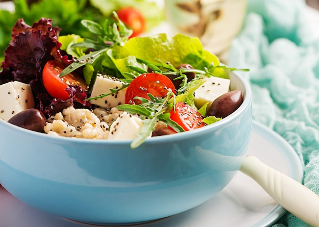 Vegan salad. breakfast bowl with oatmeal, tomatoes, cheese, lettuce,  and olives. healthy food. vegetarian buddha bowl.
