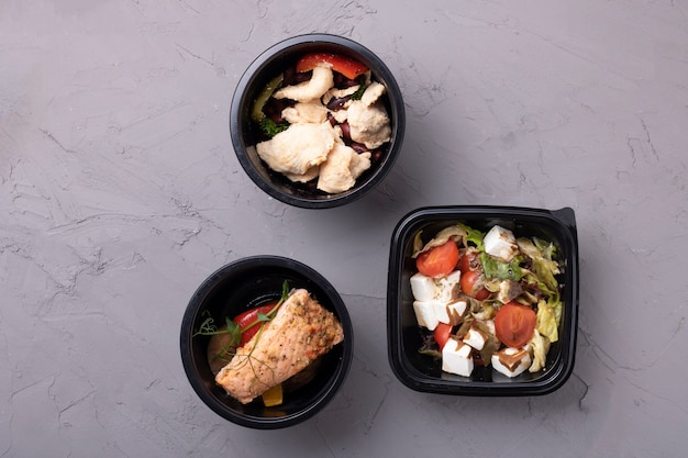 Vegan salad, stewed vegetables in containers