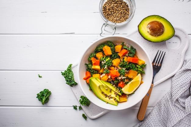 Vegan salad with rice, kale, baked pumpkin