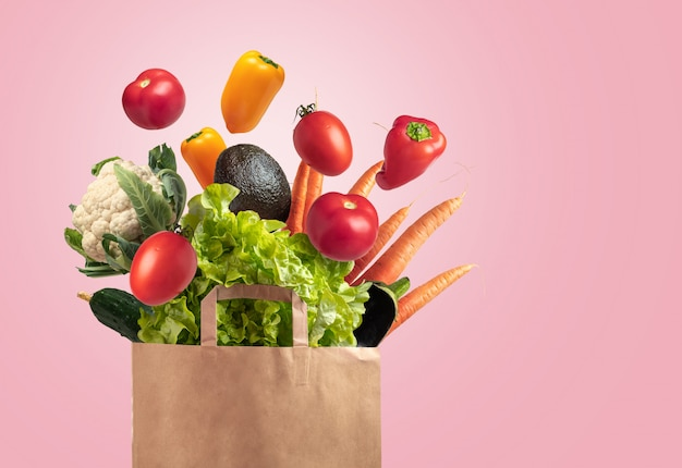 Vegetable bag with pink background, space for copy
