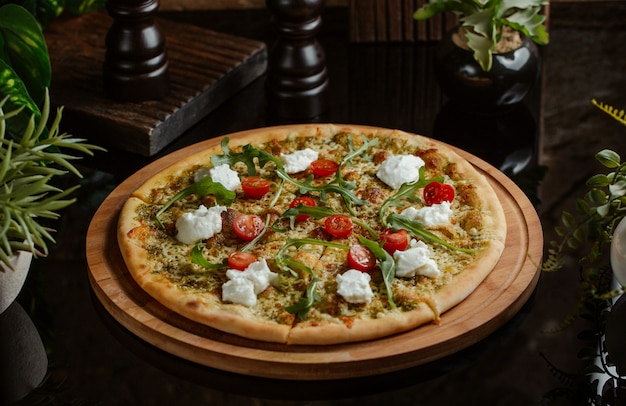 Vegetable based pizza with white cheese and cherries