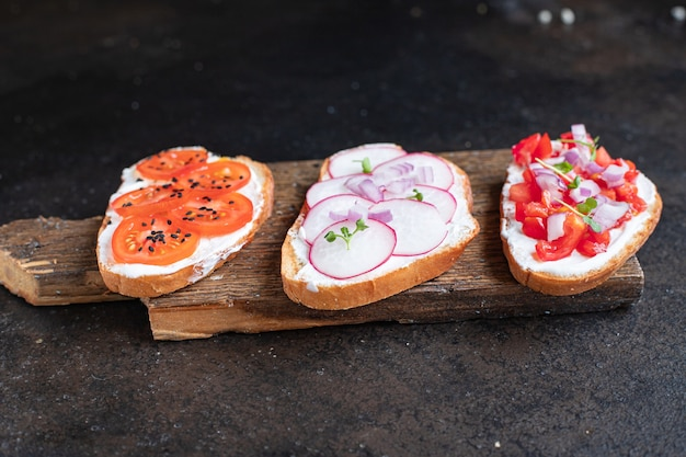 Vegetable bruschetta tomato, radish cream cheese cooking food background