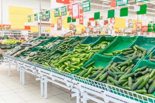 Vegetable department with a wide selection in a large supermarket. vegetarianism and a healthy lifestyle.
