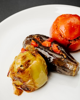 Vegetable dolma with tomato, bell pepper and eggplants with meat stuffings.