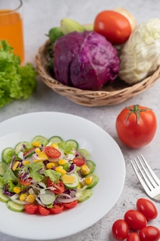 Vegetable and fruit salad on a white plate.