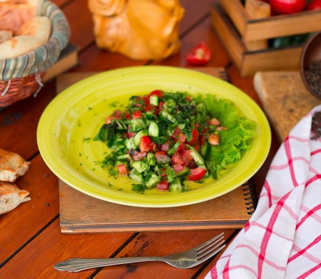 Vegetable green salad, choban salati in green plate.