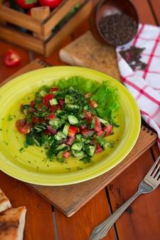 Vegetable green salad, choban salati in green plate