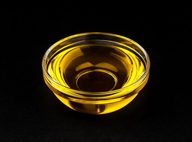 Vegetable oil in bowl on black
