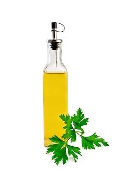 白い背景で隔離のガラス瓶にパセリと植物油または酢
