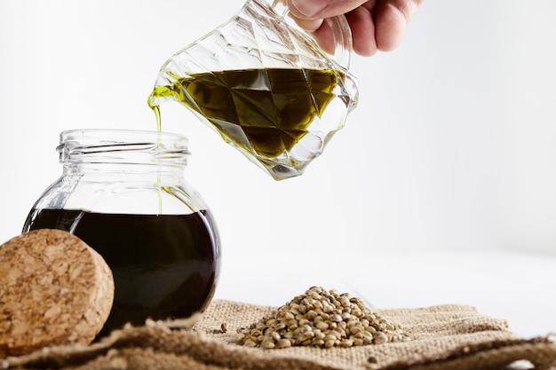 Vegetable oil and sesame seeds on a sackcloth