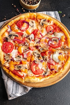 Vegetable pizza tomato pepper onion mushroom corn fresh meal snack on the table copy space