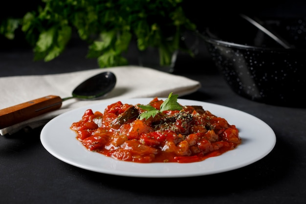 Vegetable ratatouille with fried tomato