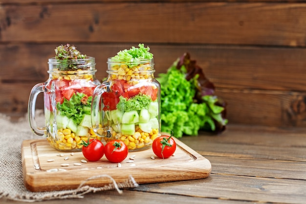 Vegetable salad, cherry tomatoes and sunflower seeds.