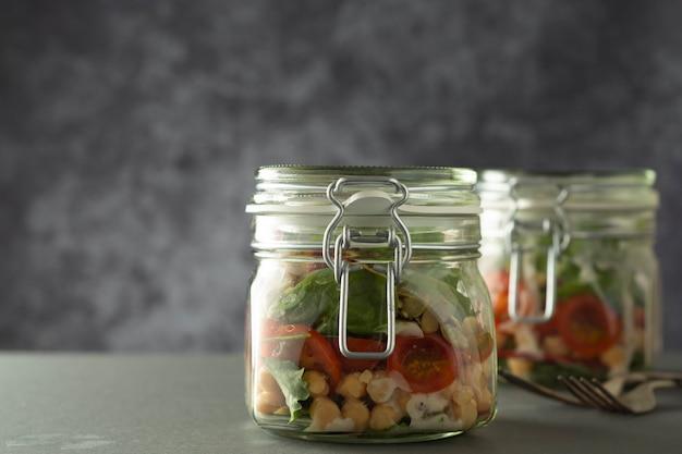 Vegetable salad in glass jar, diet, detox, clean eating and vegetarian concept, copy space.