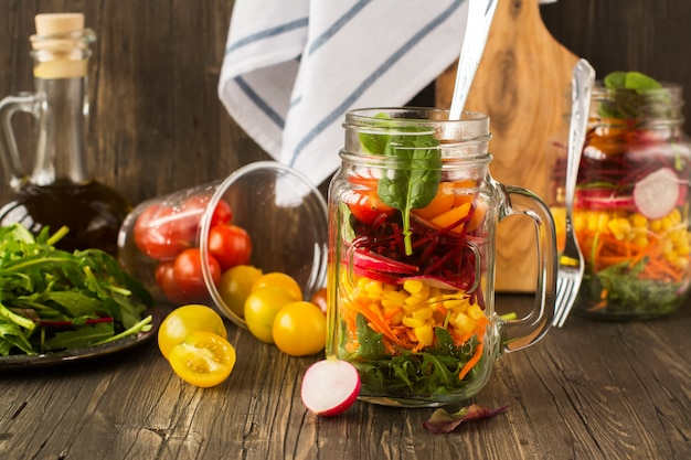 Vegetable salad in glass mason jars