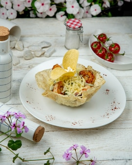 Vegetable salad in lavash with chips.