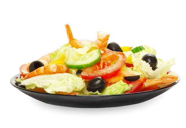Vegetable salad in plate on white