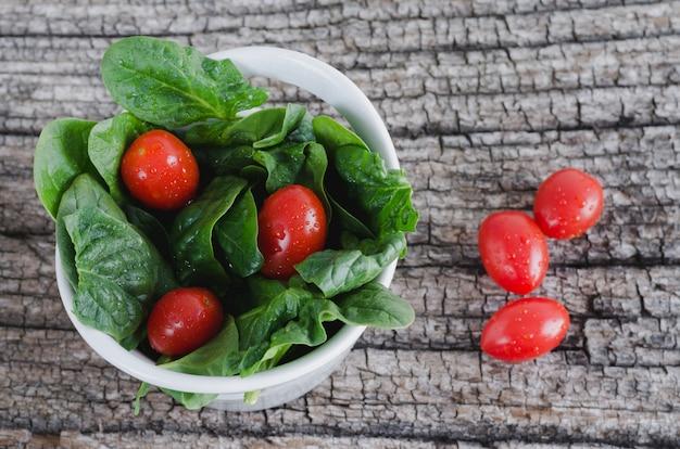 Vegetable salad on rustic wooden background.