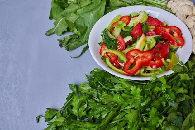 Vegetable salad sliced on blue