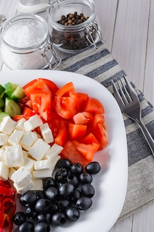 Vegetable salad of tomatoes, olives, pepper, cucumber and feta cheese