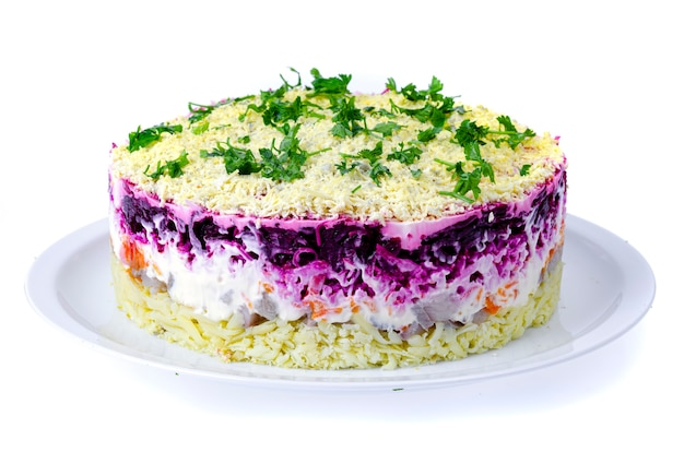 Vegetable salad with beetroot and round herring.