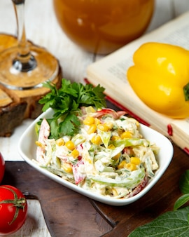 Vegetable salad with corn dressed with mayonnaise