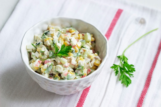 Vegetable salad with crab sticks, dressed with mayonnaise. selective focus.