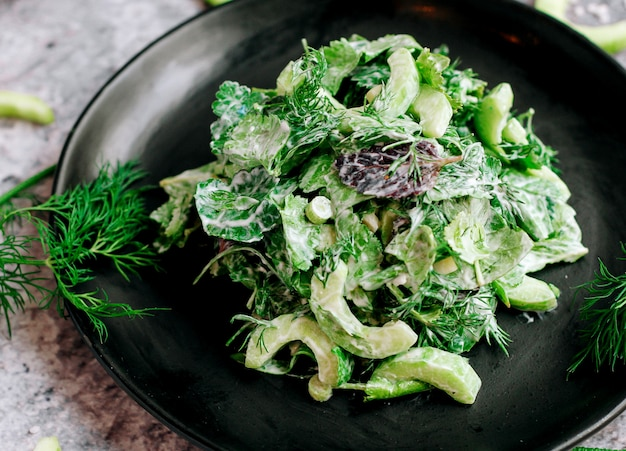 Vegetable salad with herbs and mayonnaise