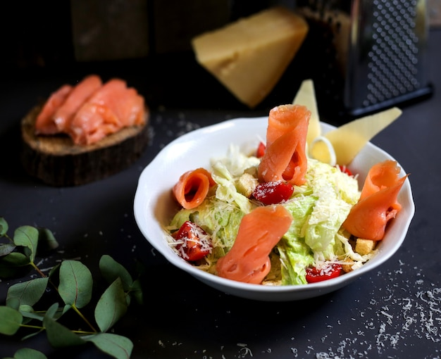 Vegetable salad with salmon fish fillet