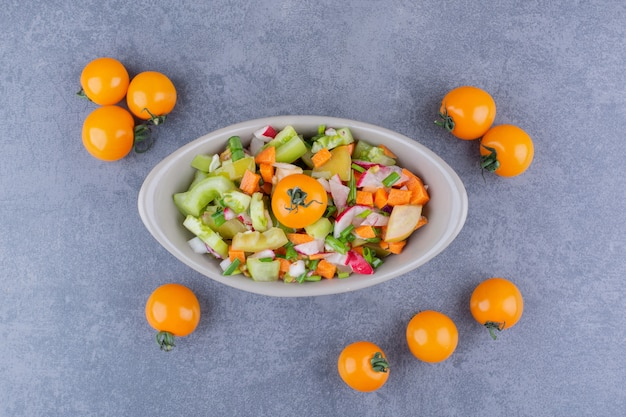 Vegetable salad with seasonal foods in a ceramic dish