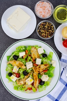 Vegetable salad with tofu and chicken breast.