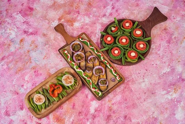 Vegetable salad in a wooden platter.
