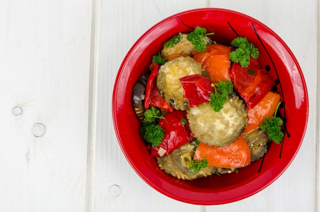 Vegetable saute with eggplant in red plate, vegetarian food
