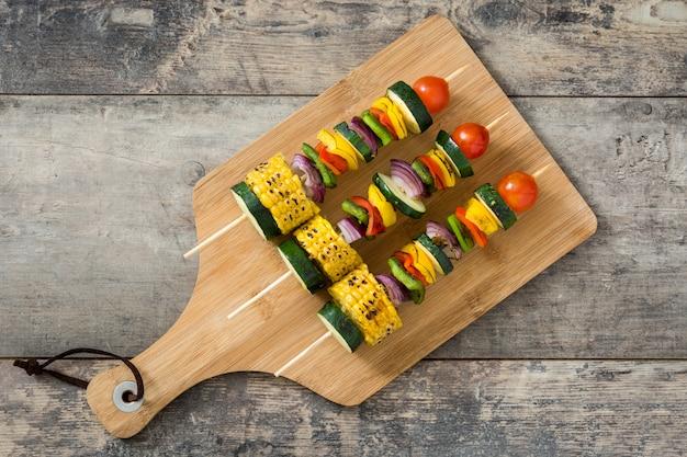 Vegetable skewers on wooden table top view