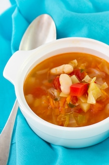 Vegetable soup in bowl and spoon