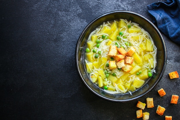 Vegetable soup green peas and small thin pasta