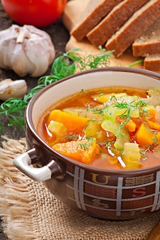 Vegetable soup on the old wooden surface