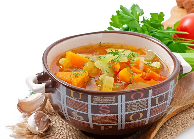 Vegetable soup on the old wooden table