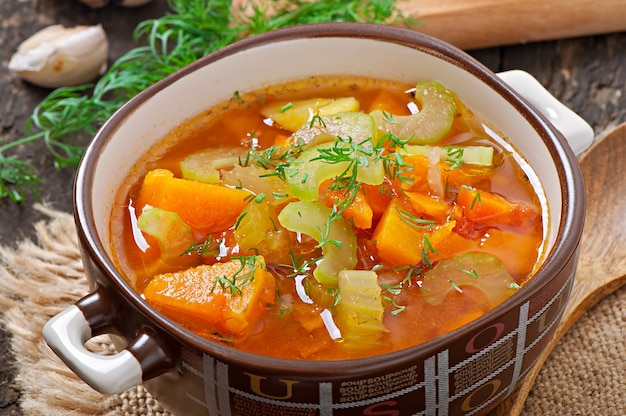 Vegetable soup on the old wooden