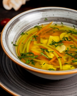 Vegetable soup served with greens