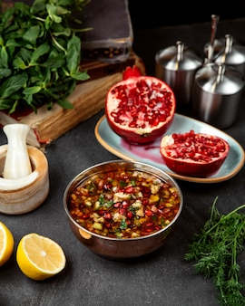 Vegetable soup topped with pomegranate