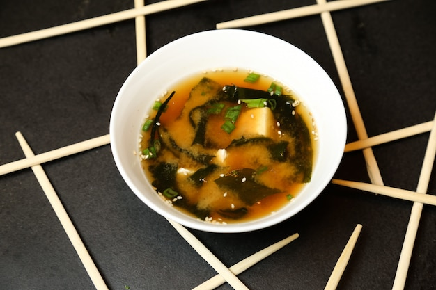 Vegetable soup topped with sesame seed top view